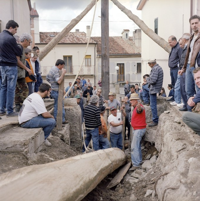 "The local men spend the day working on making the mechanism used to raise the ""Maggio""."