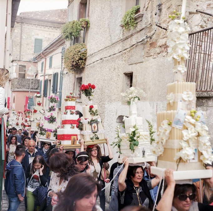 In the final procession, where they parade and dance around the town in traditional centa head-dresses, made from candles and flowers.