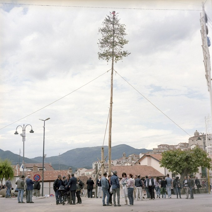 The Maggio and Cema trees are joined together and are raised over the main square of the town. Traditionally men from the town would climb the elevated tree, but due to severe rain nobody was able to climb.
